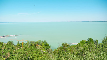 One of Europe's largest lakes - Balaton. Popular tourist tours from many continental countries. Shallow fast warming lake.