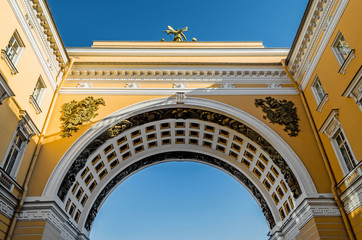 Arch, palace square, view up blue sky.