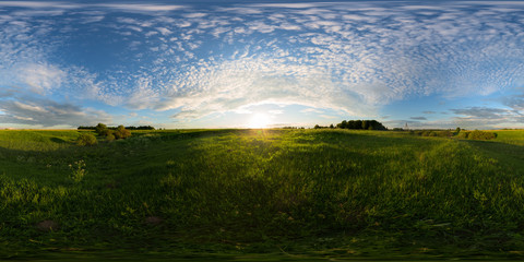 Sunset on meadow spherical 360 degree panorama