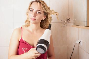 A woman drying hair.