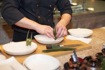 Japanese chef decorating dish