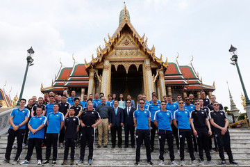 Leicester City soccer club members pose for a while as they visit the Emerald Buddha temple in Bangkok