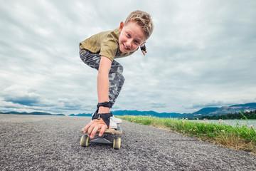Smiling boy skates on skateboard