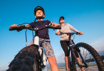 Mother with son ready for bicycle ride