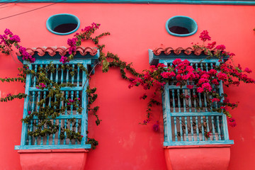 View of the windows of one of the colorful houses in center of Cartagena, Colombia.