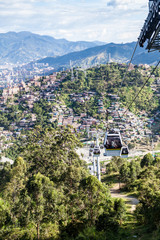MEDELLIN, COLOMBIA - SEPTEMBER 1: Medellin cable car system connects poor neighborhoods in the hills around the city.
