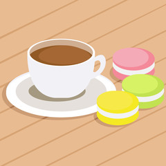 Coffee and three different colored macaroons on table