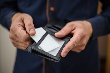 Bank card, business card, wallet, businessman holds in his hands and put the card in your wallet