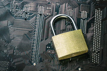 Padlock on computer motherboard. Internet data privacy information security concept