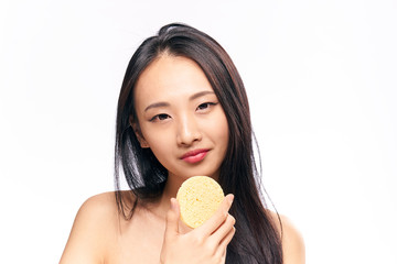 Face care, woman with sponge on isolated background portrait