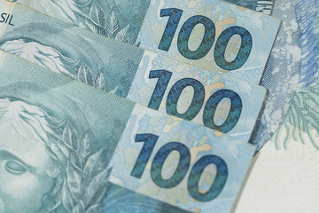 Brazilian money close up with macro. Bills called Real. Economy of Brazil concept image.