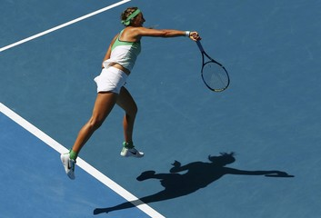 Belarus' Azarenka casts a shadow as she serves during her quarter-final match against Germany's Kerber at the Australian Open tennis tournament at Melbourne Park