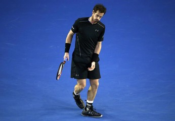 Britain's Andy Murray reacts after missing a shot during his final match against Serbia's Novak Djokovic at the Australian Open tennis tournament at Melbourne Park