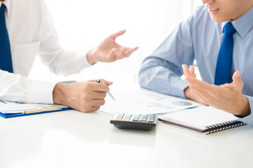 Businessmen analyzing financial documents