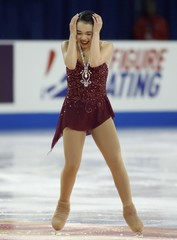 Karen Chen of the U.S. reacts at the end of her short program during the ladies singles short program at the Skate America figure skating competition in Milwaukee