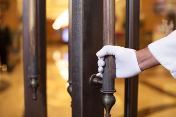 young asian porter with door