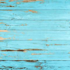 Vintage blue wood texture background with peeling paint.