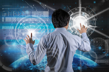 Back side of Businessman working with the modern virtual screen over the earth planet with star and trading graph background, Elements of this image furnished by NASA, Business and technology concept