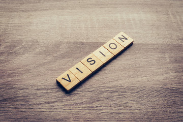 Vision word on wood table for business concept.