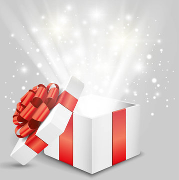 Opened gift box with red bow and lights Vector