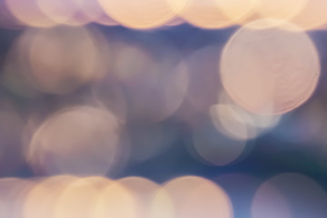 Colorful bokeh blur background from traffic light at twilight time.