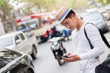 unhappy commuter, treveller using smartphone app in heavy traffic jam