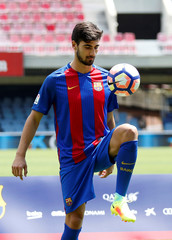 FC Barcelona's newly signed soccer player Andre Gomes plays with a ball during his presentation at Miniestadi stadium in Barcelona