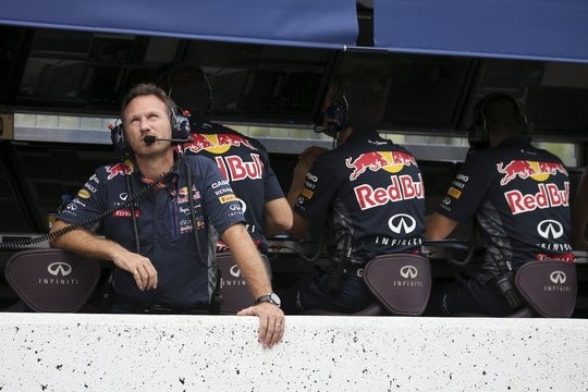 Red Bull Formula One Team Principal Christian Horner looks up at the sky during the qualifying session for the Japanese F1 Grand Prix