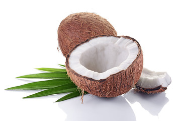 Healthy food. Fresh coconut with green palm leaves