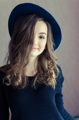 Portrait of beautiful girl in a hat