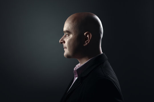 Profile of white bald man