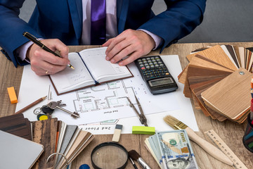 architect develop a plan house with working tools.