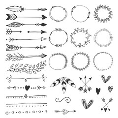 Collection of hand drawn wedding design elements, arrows, circles boders hearts and feathers.