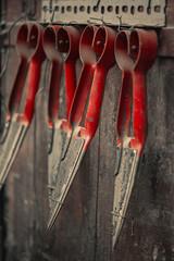 Antique scissors hang on the door. Antiques of Greece and Cyprus