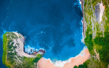 Aerial view of Tropical Sandy Beach. Sea Surface Aerial View. From Clear Blue Sky. Above Ocean. Aerial View of Forest. Palm and Paradise Beach. Big Waves, Green Background. Untouched Tropical Beach.