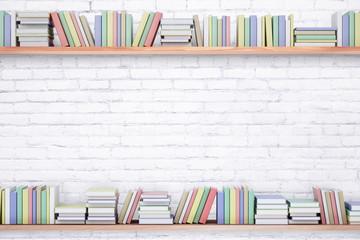 Books on brick background