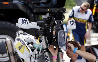 A mechanic works on the Husqvarna motorcycle of Quintanilla of Chile in the team's box ahead of the Dakar Rally 2016 in Buenos Aires