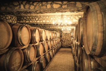 Vintage winery cellar with wine barrels