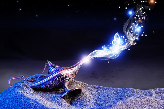 magical aladdin lamp with smoke coming out in a night resting on the dunes of a desert. magical and evocative atmosphere.