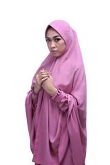 Beautiful asian muslim woman wearing veil praying