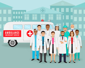Group of doctors and nurses and retro ambulance car on cityscape background. Emergency medical service employee.