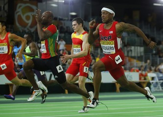 Rodgers of the U.S. runs with his laces coming loose on his shoe during the semi-final of the 60 meters at the IAAF World Indoor Athletics Championships in Portland