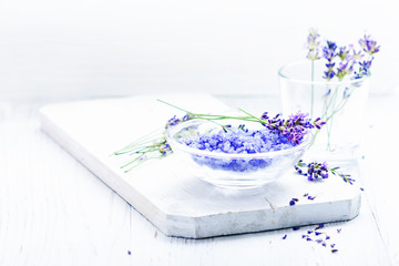 ingredients for lavender spa, flower and salt on white wooden background.