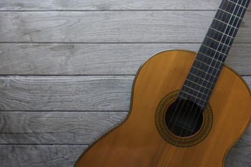old classic guitar on wood table background