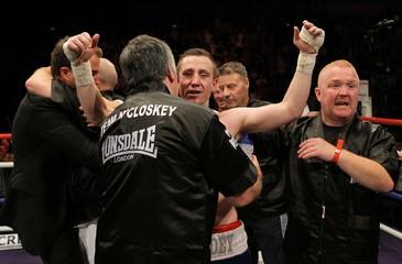 Paul McCloskey (C) celebrates winning the fight with trainer John Breen (L)