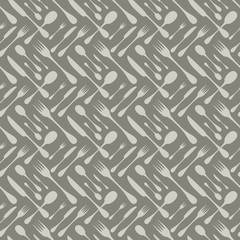 Cutlery seamless vector pattern. Silverware hand implements - spoon, knife and fork grey silhouettes on dark grey background. Restaurant and meal theme wallpaper design.