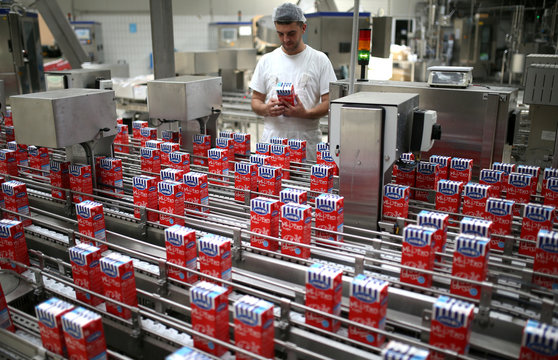Worker check milk cartons in milk factory Milkos in Sarajevo