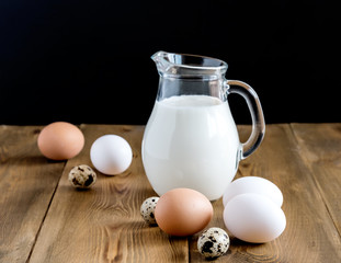 Milk and eggs Wooden background