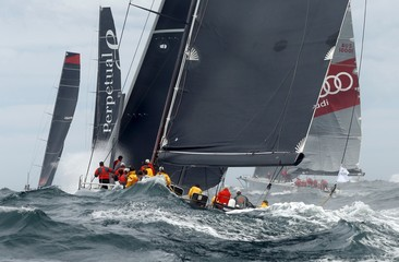 Crew members aboard the American entry Rambler 88 sail through the ocean swell after leaving Sydney Harbour during the 71st Sydney to Hobart Yacht race