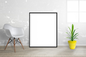 Empty picture frame for mockup. The frame is leaning against the wall, chair and plant beside.